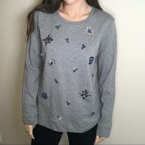 Gray sweater with blue themed rhinestones